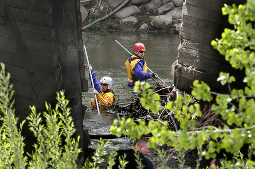 Scott Sommerdorf  |  The Salt Lake Tribune              Search efforts for a 3-year-old boy presumed drowned continued further down river at a bridge near Exchange Road and 21st Street in Ogden, Monday, April 30, 2012. Searchers extended their search pattern further north on the Weber River Monday morning.