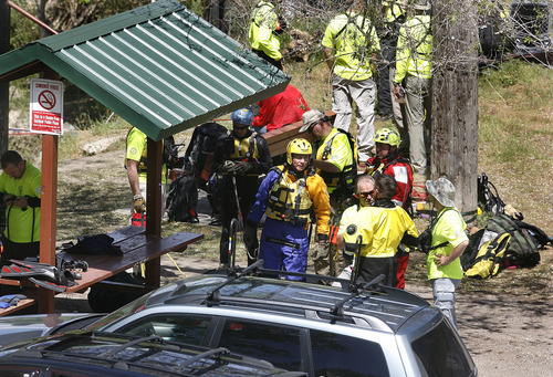 Scott Sommerdorf  |  The Salt Lake Tribune              Divers put on their gear prior to beginning their search for a missing 3-year-old boy in the Weber River just north of Exchange Roadt in Ogden, Sunday, April 29, 2012.