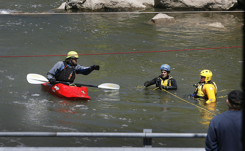 Scott Sommerdorf  |  The Salt Lake Tribune              Search efforts continued further downriver at a bridge near Exchange Road and 21st Street in Ogden, Monday, April 30, 2012. Searchers extended their search pattern further north on the Weber River Monday morning.