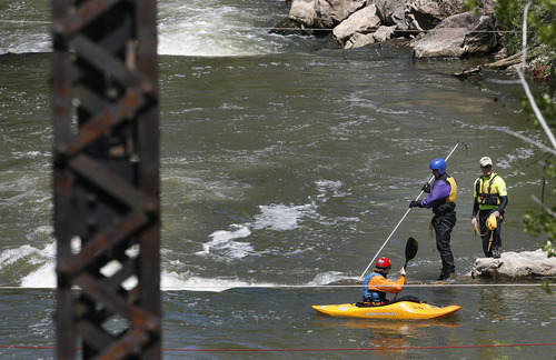 Scott Sommerdorf  |  The Salt Lake Tribune              A search and rescue worker uses a long probe to search for a missing 3-year-old boy in the Weber River just north of Exchange Road in Ogden, Sunday, April 29, 2012.