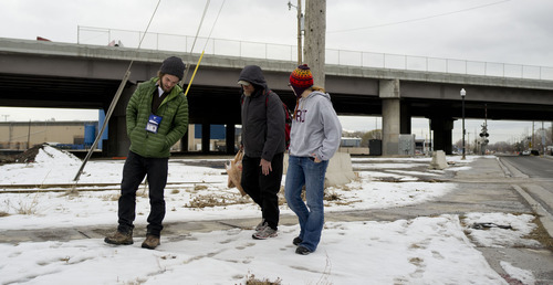 Trent Nelson  |  The Salt Lake Tribune Buddy Tymczyszyn, left, and Kimberly Bell, right, of Volunteers of America, spoke with a homeless man named Cliff while working on the Utah's annual statewide Point-in-Time homeless count in Salt Lake City, Utah Thursday, January 26, 2012.