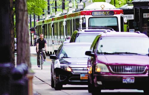 Kim Raff | The Salt Lake Tribune A person rides a bicycle down Main Street in downtown Salt Lake City, Utah on April 30, 2012.