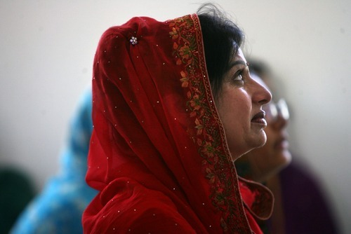 Kim Raff | The Salt Lake Tribune Surinber Kaur listens during the Sikhs of Utah worship service at the Sikh Temple in Taylorsville on April 22, 2012.