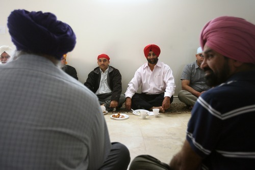 Kim Raff | The Salt Lake Tribune Men eat food together before a weekly Sikh worship service at the Sikhs of Utah Temple in Taylorsville on April 22, 2012.
