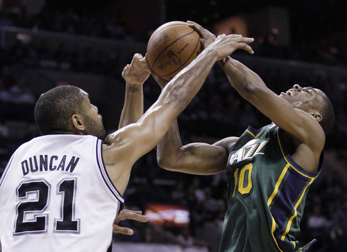 Utah Jazz's Alec Burks (10) looks for a shot against San Antonio Spurs' Tim Duncan (21) during the first quarter of Game 2 of a first-round NBA basketball playoff series, Wednesday, May 2, 2012, in San Antonio. (AP Photo/Eric Gay)