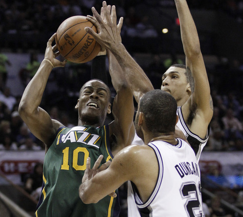 Utah Jazz's Alec Burks (10) works against San Antonio Spurs' Tim Duncan, center, and Danny Green during the first quarter of Game 2 of a first-round NBA basketball playoff series, Wednesday, May 2, 2012, in San Antonio. (AP Photo/Eric Gay)