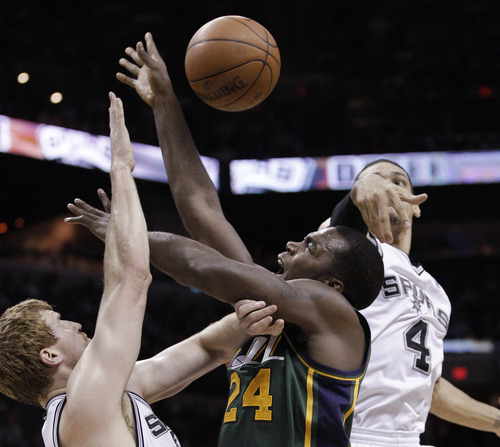 Utah Jazz's Paul Millsap (24) works between San Antonio Spurs' Matt Bonner, left, and Danny Green during the second quarter of Game 2 of a first-round NBA basketball playoff series, Wednesday, May 2, 2012, in San Antonio. (AP Photo/Eric Gay)