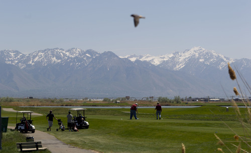 Trent Nelson  |  The Salt Lake Tribune Golfers tee off on the 9th hole at Salt Lake City's Wingpointe golf course Wednesday, May 2, 2012.  A demand from the FAA could cause a dramatic increase in Wingpointe's lease.