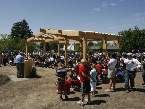 Rick Egan  | The Salt Lake Tribune   Crowds gather to celebrate the grand opening of the community garden in Holladay,  Friday, May 4, 2012. The Mount Olympus Garden is a cooperative venture for Howard R. Driggs Elementary School, Olympus Junior High School, Salt Lake City, Holladay City, Salt Lake County, and New Roots of Utah in partnership with the International Rescue Committee.