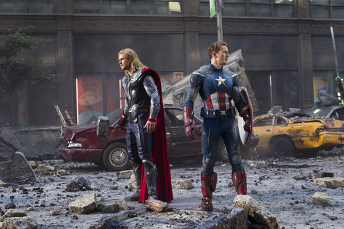 In this film image released by Disney, Thor portrayed by Chris Hemsworth, left, and Captain America, portrayed by Chris Evans, are shown in a scene from