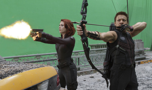 In this film image released by Disney, Scarlett Johansson portraying Black Widow, left, and Jeremy Renner, portraying Hawkeye, are shown during the filming of Marvel's