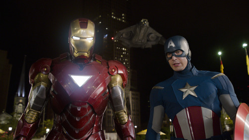 In this film image released by Disney, Iron Man, portrayed by Robert Downey Jr., left, and Captain America, portrayed by Chris Evans, are shown in a scene from