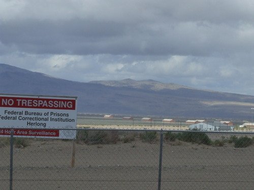 Brandon Loomis | The Salt Lake Tribune (4/26/12) The minimum-security prison camp at Herlong, Calif., with bunks housing about 130 inmates in the building at right, is temporary home to Salt Lake City environmental activist Tim DeChristopher, who disrupted a federal Bureau of Land Management oil and gas lease sale by bidding on land tracts. He is serving a two-year sentence at the camp northwest of Reno, Nev., and has routine access to short walks on the desert around the complex.