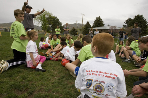 Paul Fraughton | The Salt Lake Tribune Jeff Garn, who formed The Red Devils Soccer Club, gives instruction to kids with autism and their volunteer mentors  at a soccer clinic run by the club at the Carmen B. Pingree School and Sunnyside Park in Salt Lake City.   Thursday, May 3, 2012