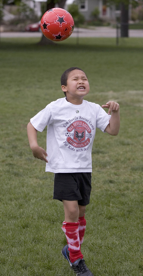 Paul Fraughton | The Salt Lake Tribune Charlie Cunningham practices heading the ball, Charlie joined other kids with autism at a soccer clinic run by the RedDevils Soccer Club at the Carmen B. Pingree School and Sunnyside Park in Salt Lake City.   Thursday, May 3, 2012