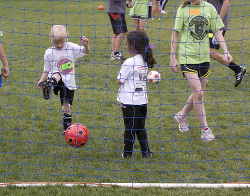 Paul Fraughton | The Salt Lake Tribune Will Leger kicks the ball into the net at The Red Devils Soccer Camp for Kids  With Autism held at Sunnyside Park and The Carmen B. Pingree School in Salt Lake City.  Thursday, May 3, 2012