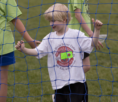 Paul Fraughton | The Salt Lake Tribune Will Leger checks out  the net as he participates  in  The Red Devils Soccer Camp for Kids  With Autism held at Sunnyside Park and The Carmen B. Pingree School in Salt Lake City.  Thursday, May 3, 2012