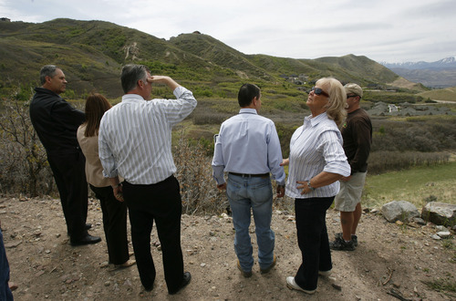 Francisco Kjolseth  |  The Salt Lake Tribune Salt Lake County Mayor Peter Corroon, center left, looks out over Little Valley alongside Draper City Mayor Darrell Smith with his wife, Launi, as they join other public and city and county officials who attended the ribbon-cutting on Monday, April 30, 2012, which officially connects thousands of acres in Corner Canyon and Traverse Ridge Open Space. The 88 miles of trails are now connected through a tunnel under Traverse Ridge road in Draper and there are plans for more trails to be built.