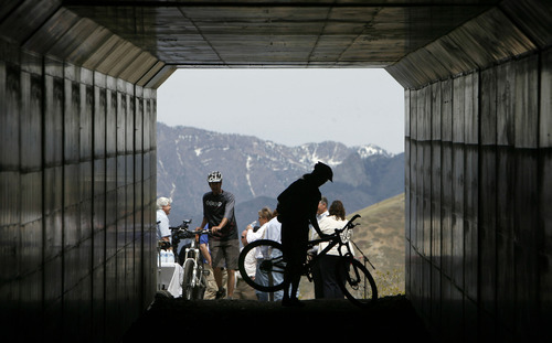 Francisco Kjolseth  |  The Salt Lake Tribune Salt Lake County and Draper City get ready to hold a ribbon-cutting ceremony to mark the opening of the new Little Valley Trail at Traverse Ridge on Monday, April 30, 2012, where Little Valley and Corner Canyon are now connected through a tunnel under Traverse Ridge Road.