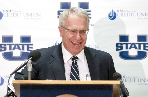 President Stan Albrecht speaks during a press conference, Friday, announcing that Utah State University will be joining the Mountain West Conference. (AP Photo/The Herald Journal, Eli Lucero)