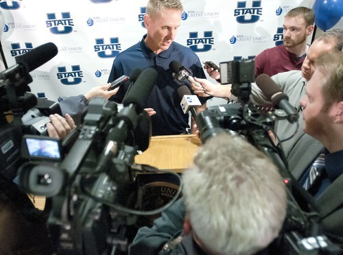 Football coach Gary Andersen speaks to the media, Friday, following a press conference announcing that Utah State University will be joining the Mountain West Conference. (AP Photo/The Herald Journal, Eli Lucero)