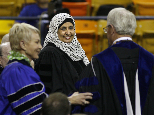 Scott Sommerdorf  |  The Salt Lake Tribune              Norah Abdullah Al-Faiz, a 1982 USU graduate, and Saudi Arabia's Vice Minister for Girl's Education stands to accept her Honorary Doctorate in Education from USU President Stan L. Albrecht at Utah State University's Commencement, Saturday, May 5, 2012.