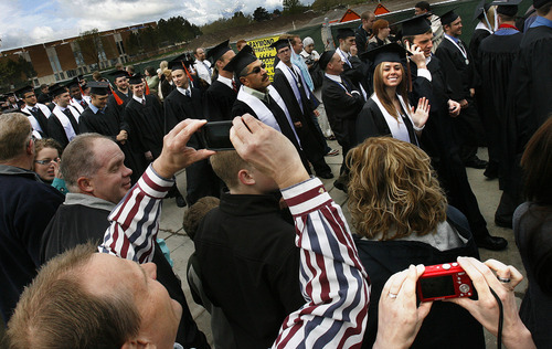 Scott Sommerdorf  |  The Salt Lake Tribune              Family and friends make photos of graduates as they file by in the processional prior to Utah State University's Commencement, Saturday, May 5, 2012.