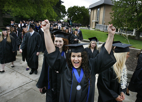 Scott Sommerdorf  |  The Salt Lake Tribune              Utah State's Caine College of the Arts student Heidi Randall celebrates with classmates during the procession to USU's Commencement, Saturday, May 5, 2012.