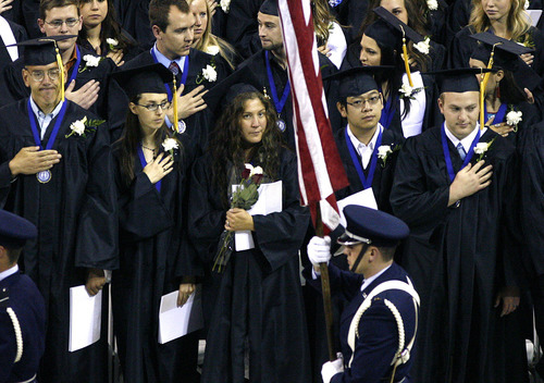Scott Sommerdorf  |  The Salt Lake Tribune              Graduates stand during the presentation of the colors at Utah State University's Commencement, Saturday, May 5, 2012.