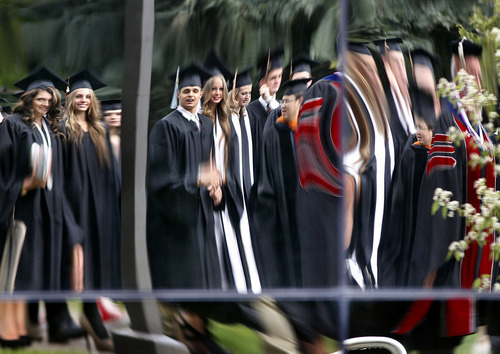 Scott Sommerdorf  |  The Salt Lake Tribune              Distorted reflections of USU students in the processional to Utah State University's Commencement ceremony, Saturday, May 5, 2012.