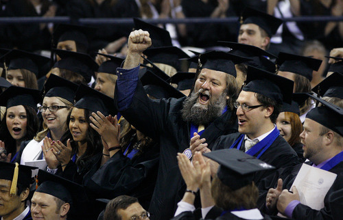 Scott Sommerdorf  |  The Salt Lake Tribune              A graduate in the USU Caine College of the Arts celebrates with classmates as their degrees are conferred by USU President Stan L. Albrecht. Utah State University Commencement on Saturday. The College of Science Valedictorian is Victor Carlson. Carlson was among the group of people who rescued three children from the icy Logan River this past New Year's Eve.