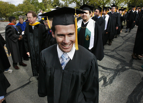 Scott Sommerdorf  |  The Salt Lake Tribune              The College of Science Valedictorian, Victor Carlson makes his way in the procession during Utah State University Commencement, Saturday, May 5, 2012. Carlson was among the group of people who rescued three children from the icy Logan River this past New Year's Eve.