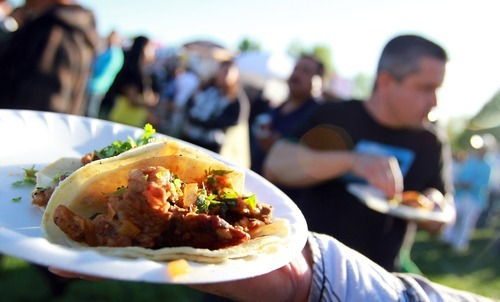 Festival goers enjoy authentic Carne Asada at the annual Cinco De Mayo party at Centennial Park in West Valley City Saturday afternoon. Stephen Holt / Special to the Tribune
