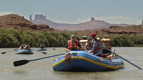 Al Hartmann  |  Tribune file photo Four Alpine Valley Care Center residents with one staff member assigned to each takes to the Colorado River above Moab on a one day whitewater raft trip. The three rafts are professionally guided by