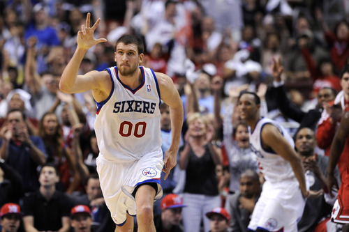 Philadelphia 76ers' Spencer Hawes celebrates after hitting a 3-pointer against the Chicago Bulls during the first half of Game 4 in a first-round NBA basketball playoff series, Sunday, May 6, 2012, in Philadelphia. (AP Photo/Michael Perez)