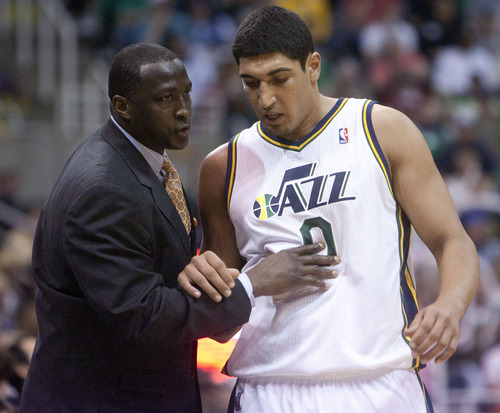 Jeremy Harmon  |  The Salt Lake Tribune  Ty Corbin talks with Enes Kanter on the sidelines as the Jazz host the Spurs in the first round of the NBA playoffs at EnergySolutions Arena in Salt Lake City, Saturday, May 5, 2012.