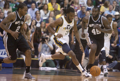 Jeremy Harmon  |  The Salt Lake Tribune  Demarre Carroll moves the ball between San Antonio's Kawhi Leonard and Dejuan Blair as the Jazz host the Spurs in the first round of the NBA playoffs at EnergySolutions Arena in Salt Lake City, Saturday, May 5, 2012.
