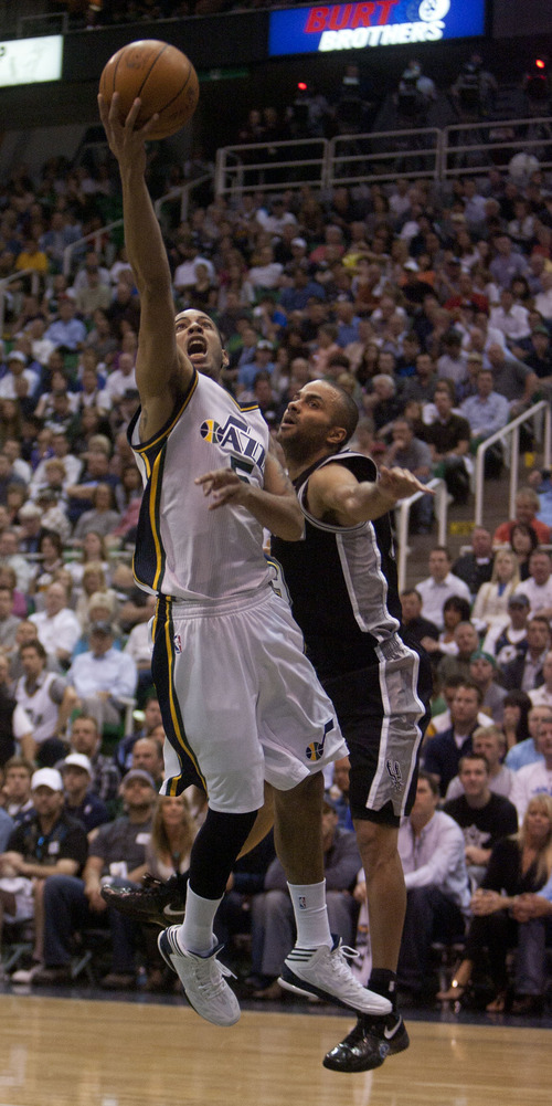 Jeremy Harmon  |  The Salt Lake Tribune  Devin Harris drives past Tony Parker as the Jazz host the Spurs in the first round of the NBA playoffs at EnergySolutions Arena in Salt Lake City, Saturday, May 5, 2012.