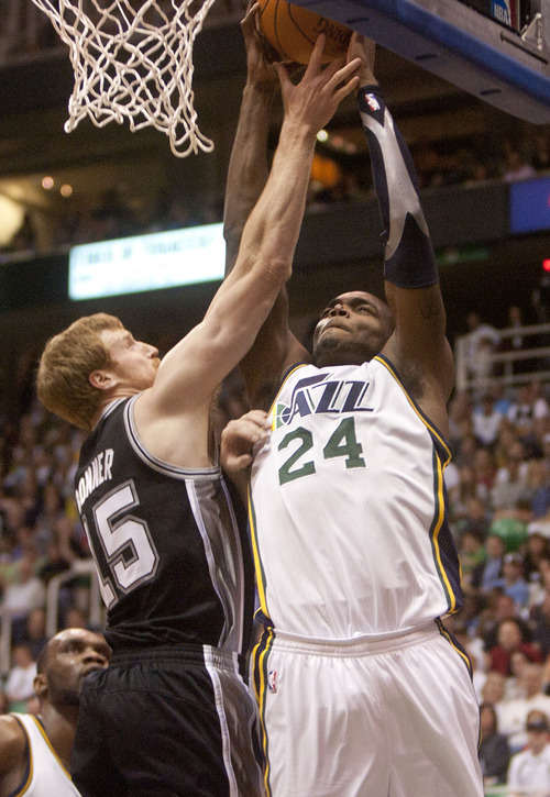 Jeremy Harmon  |  The Salt Lake Tribune  Paul Millsap is fouled by Matt Bonner as the Jazz host the Spurs in the first round of the NBA playoffs at EnergySolutions Arena in Salt Lake City, Saturday, May 5, 2012.