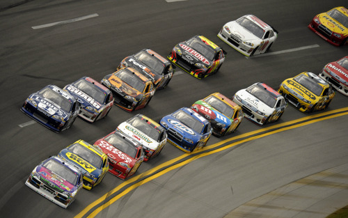 Michael Waltrip (55) leads a pack through Turn 2 during the NASCAR Sprint Cup Series auto race at Talladega Superspeedway in Talladega, Ala., Sunday, May 6, 2012. (AP Photo/Kevin Glackmeyer)