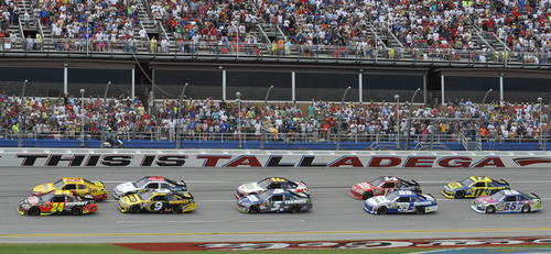 Jeff Gordon (24) leads the pack at the start of the NASCAR Sprint Cup Series auto race at Talladega Superspeedway in Talladega, Ala., Sunday, May 6, 2012. (AP Photo/Rainier Ehrhardt)