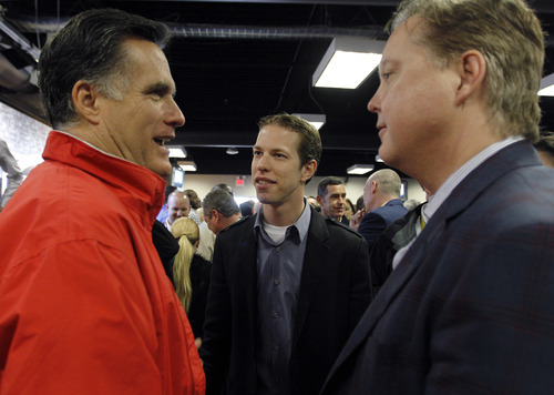 Republican presidential candidate, former Massachusetts Gov. Mitt Romney, left, talks with NASCAR CEO Brian France, right, and driver Brad Keselowski, center, before the NASCAR Daytona 500 Sprint Cup series auto race at Daytona International Speedway in Daytona Beach, Fla., Sunday, Feb. 26, 2012. (AP Photo/Pool, Chris Graythen)