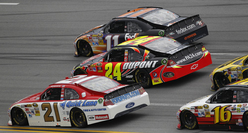 Denny Hamlin (11) leads Jeff Gordon (24), Trevor Bayne (21) and Greg Biffle (16) early in the NASCAR Sprint Cup Series auto race at Talladega Superspeedway in Talladega, Ala., Sunday, May 6, 2012. (AP Photo/Dave Martin)