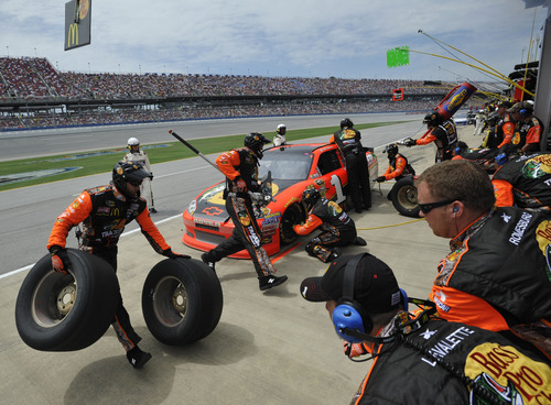 Jamie McMurray (1) receives service at a pit stop during the NASCAR Sprint Cup Series auto race at Talladega Superspeedway in Talladega, Ala., Sunday, May 6, 2012. (AP Photo/Rainier Ehrhardt)