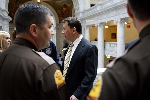 Trent Nelson  |  The Salt Lake Tribune Rep. Stephen Sandstrom, accompanied by two Utah Highway Patrol Troopers, at the state capitol in Salt Lake City, Utah, Tuesday, February 15, 2011. Sandstrom, and Rep. Chris Herrod reported receiving threatening letters after their work on immigration reform bills.