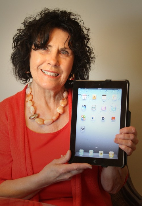 Rick Egan  | The Salt Lake Tribune   Eva Heiner, 75, holds the iPad she received as a present, at her home in Salt Lake, Thursday, May 3, 2012. They are now offering classes at senior citizens centers and community centers for seniors on how to use these devices.