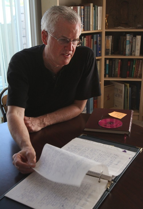 Tribune file photo Steve Powell thumbs through pages in Susan Powell's journal, at his home in Puyallup Washington on Aug. 20.