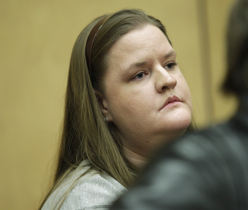 Steve Powell's daughter Alina Powell watches as her father appears in a Pierce County Superior Court hearing, Monday, April 23, 2012, in Tacoma, Wash. Alina Powell defended her father outside of court, saying that evidence against him in his upcoming voyeurism trial has been fabricated. (AP Photo/Ted S. Warren)