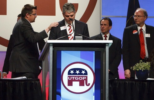 Leah Hogsten  |  The Salt Lake Tribune After Second District Republican contender Milt Hanks alleged that his fellow candidates David Clark, Cherilyn Eagar, Howard Wallack and Chuck Williams conspired to oust rival Chris Stewart with some damaging information--Eagar, Williams and Wallack all withdrew their nominations and vocally put their support behind David Clark, center above.  The Utah Republican Party held its nominating convention Saturday, April 21 2012 in Sandy at the South Towne Exposition Center.