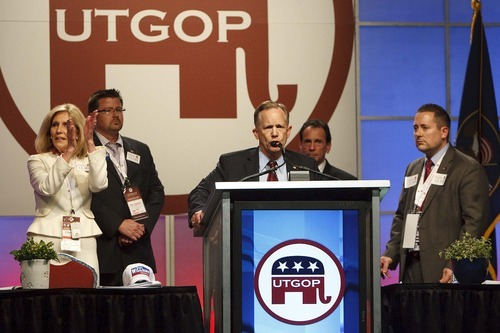 Leah Hogsten  |  The Salt Lake Tribune After Second District Republican contender Milt Hanks alleged that his fellow candidates David Clark, Cherilyn Eagar, Howard Wallack and Chuck Williams conspired to oust rival Chris Stewart with some damaging information--Eagar (left), Williams (center) and Wallack (in background) all withdrew their nominations and vocally put their support behind David Clark.  The Utah Republican Party held its nominating convention Saturday, April 21 2012 in Sandy at the South Towne Exposition Center.